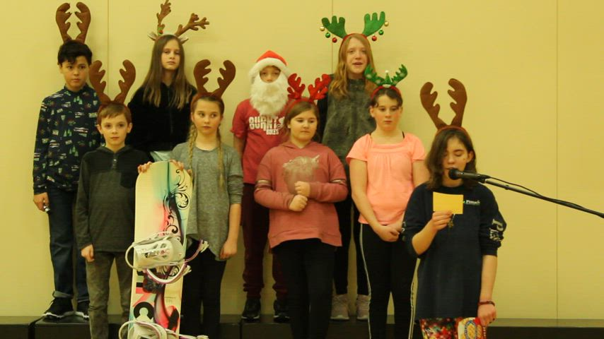 A poem about reindeers is presented by grade 6 students.